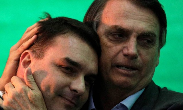 80781087_Federal-deputy-Jair-Bolsonaro-embraces-his-son-Flavio-Bolsonaro-during-the-national-convent